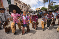 Children wearing sombreros and chaps in the street. June 25, 2017 Cotacachi, Ecuador: children wearing sombreros and chaps at the Inti Raymi celebrations stock photos