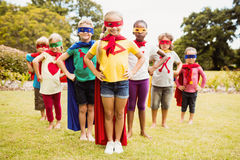 Children wearing superhero costume standing Royalty Free Stock Photos