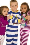 Children wearing winter pajamas with freezing cold expression Royalty Free Stock Image
