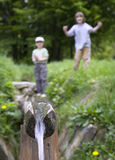 Children by the well Stock Photography