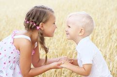 Children in wheat field Royalty Free Stock Photography