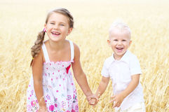 Children in wheat field Stock Images