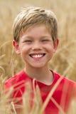 Children in a wheat field Stock Image