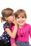 Children whispering Royalty Free Stock Image
