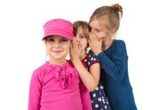 Children whispering Stock Images