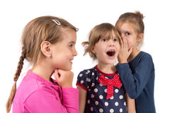 Children whispering Stock Photos