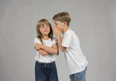 Children whispering stock photography