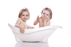Children in white bath tub Stock Images