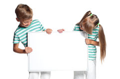 Children with white blank Royalty Free Stock Images