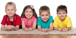 Children on the white carpet Royalty Free Stock Photos
