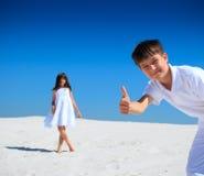 Children on white sand beach Stock Images
