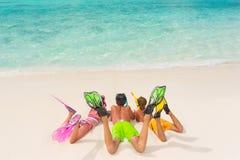 Children on white sand beach stock photos