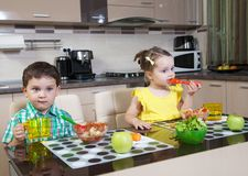 Children who eat food in the kitchen Royalty Free Stock Photo