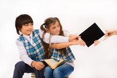 Children who are struggling for tablet pc Royalty Free Stock Image