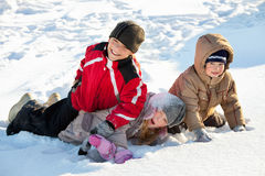 Children in the winter. Children in the snow in winter royalty free stock images