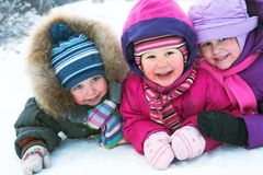 Children in winter. Group of children having fun in winter time royalty free stock image