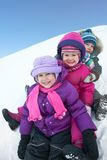 Children in winter. Group of children having fun in winter time royalty free stock photo