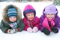 Children in winter. Group of children playing on snow in winter time royalty free stock photos