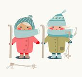 Children in Winter Cloth and Skies Stock Images