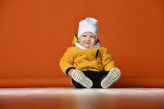 Children in winter clothes. Kids in down jackets. royalty free stock images