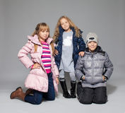 Children in winter clothes stock images
