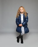 Children in winter clothes. Kids in down jackets. Fashion child stock photography