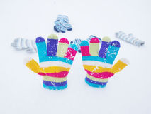 Children winter gloves in snow Royalty Free Stock Photos