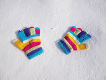 Children winter gloves in snow Stock Photography