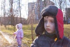 Children winter outdoor. Children stroll through the park Stock Photography
