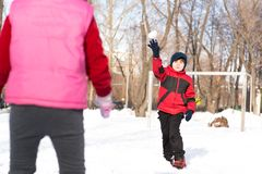 Children in Winter Park playing snowballs Royalty Free Stock Photo