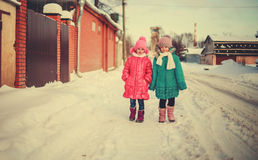 Children on winter roads. Happy children on winter roads, children smiling Royalty Free Stock Photo