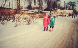 Children on winter roads. Happy children on winter roads, children smiling Royalty Free Stock Photos
