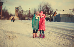 Children on winter roads. Happy children on winter roads, children smiling Stock Photography