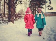 Children on winter roads. Happy children on winter roads, children smiling Stock Image