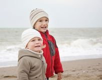 Children on winter sea background Stock Photo