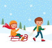 Children winter sledding Stock Photos