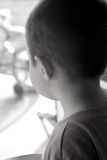 Children-Wishing to go Outside. Little boy looking out the windowing hoping to go outside Royalty Free Stock Photography