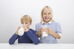 Free Children With Glasses Of Milk At Table Royalty Free Stock Photos - 35909158