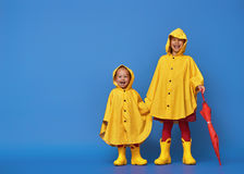 Children With Red Umbrella Royalty Free Stock Photos