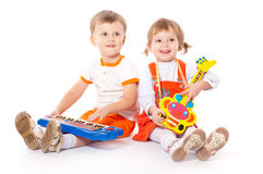 Children With Toys In The Studio Royalty Free Stock Photos