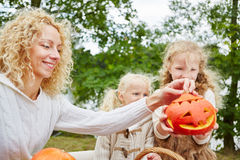 Children and woman playing with pumpkins Royalty Free Stock Photo