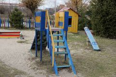 Children`s wooden colored buildings on the playground in the grass. Children  wooden colored buildings on the playground in the grass outside stock image