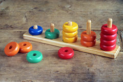 Children wooden colorful figures Royalty Free Stock Photo
