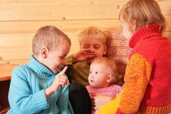 Children in the wooden room Royalty Free Stock Photography