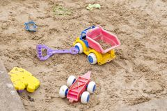 Children wooden sand box. With some plastic toys Royalty Free Stock Photos