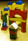 Children wooden toy. Colorfull wooden pieces construction game royalty free stock photos