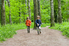 Children in the woods. Three year old identical twins running down the forest path Royalty Free Stock Photography