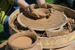 Children work with clay using pottery wheel Royalty Free Stock Images