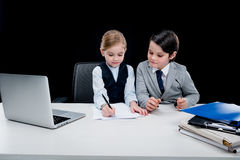 Children working with documents at workplace Royalty Free Stock Photo