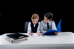 Children working with documents at workplace Royalty Free Stock Photos